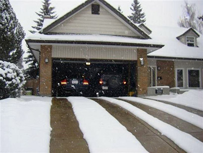 Heated driveway featuring two 24-inch heated tire tracks.
